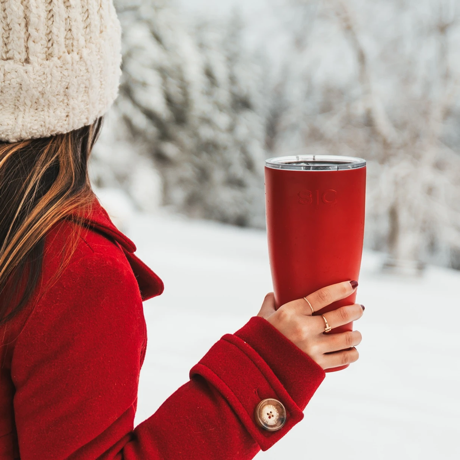 woman holding a red SIC 30 OZ. Tumbler