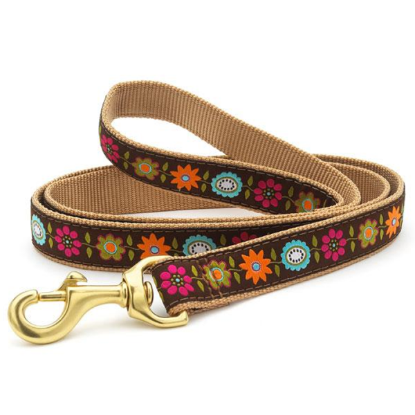 A strong webbed leash with bright flowers.