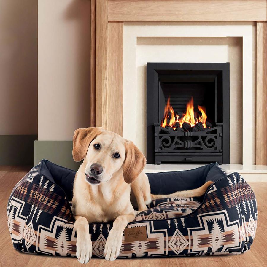 Labrador on a Harding Kuddler by fireplace